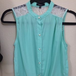 light blue colored button up blouse